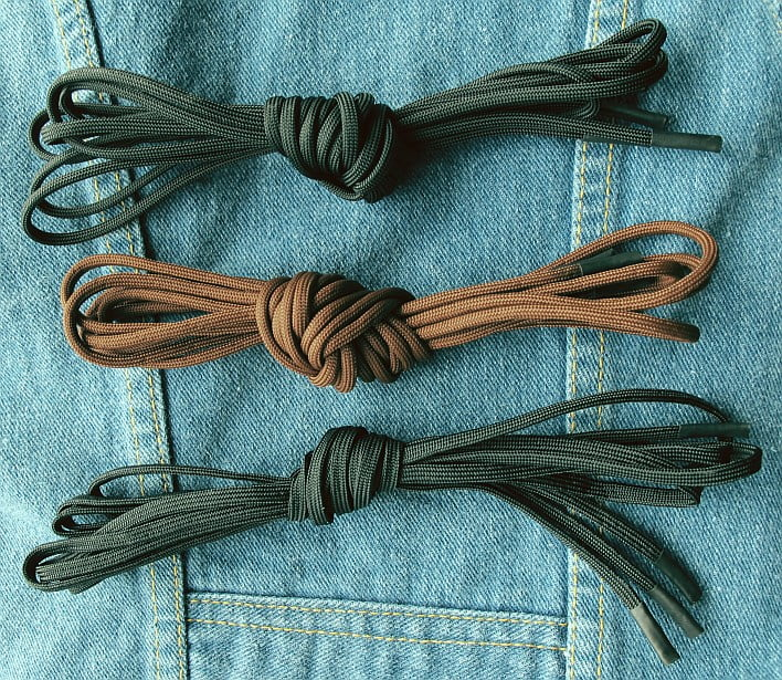 east side rerides makes boot laces Top to bottom: Round black, round brown, flat black.